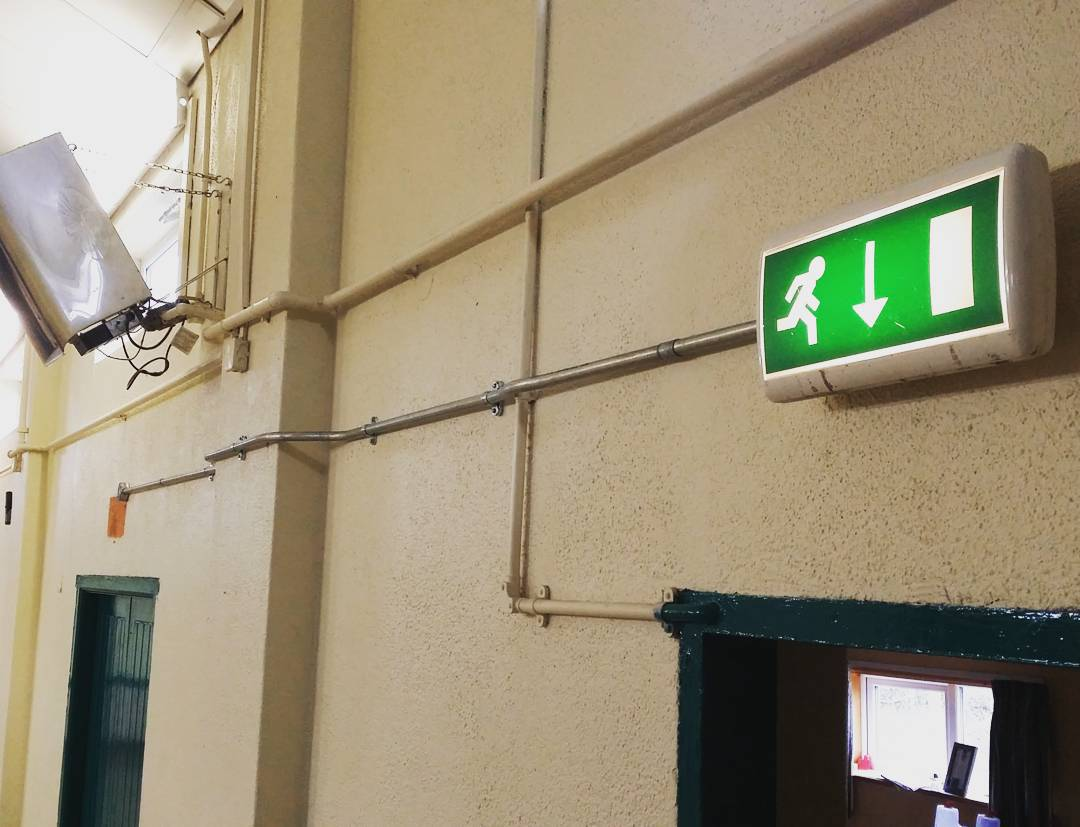 The Exit sign is now over the actual Exit door