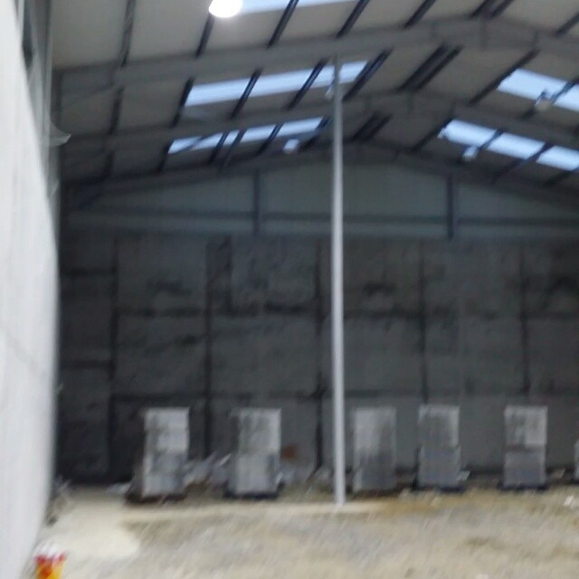 All 12 Led high bay lights in the indoor pitch area now hanging and lighting only another 8 in the handball alley to go